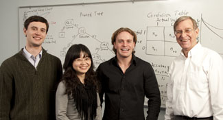 Jingjing Ye, Steven Gregory and Michael Fulmer of the SMU 2010 Data Mining Team with sponsor Professor Tom Fomby