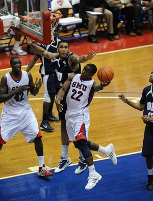 SMU's Papa Dia (42) and Mike Walker (22) in Wednesday's game against Oral Roberts University