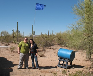 SMU Embrey Human Rights Program students Jordan Johansen, left, and Adriana Martinez stand at a water station for migrants in the Arizona desert during their Student Leadership Initiative trip in January 2011.