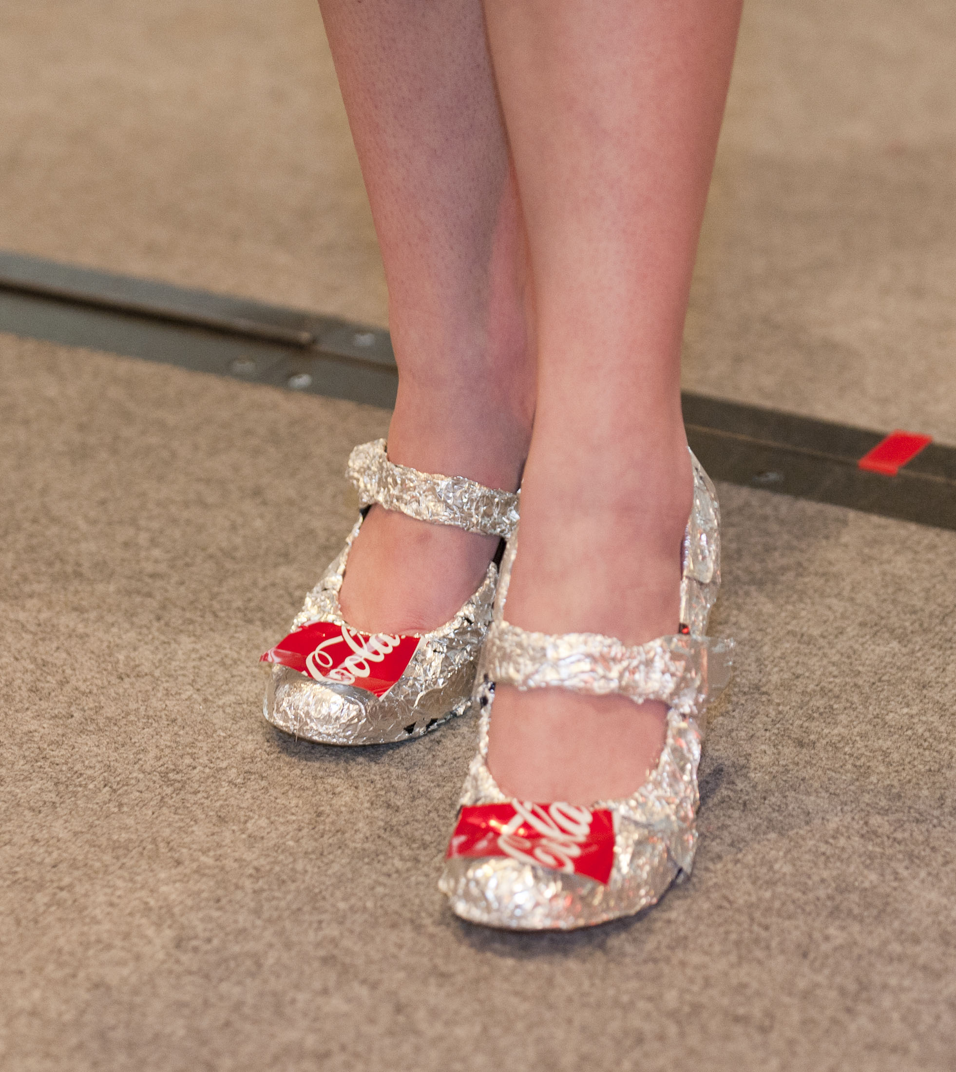Diana Mansour's design shines with Coca-Cola can-inspired shoes.