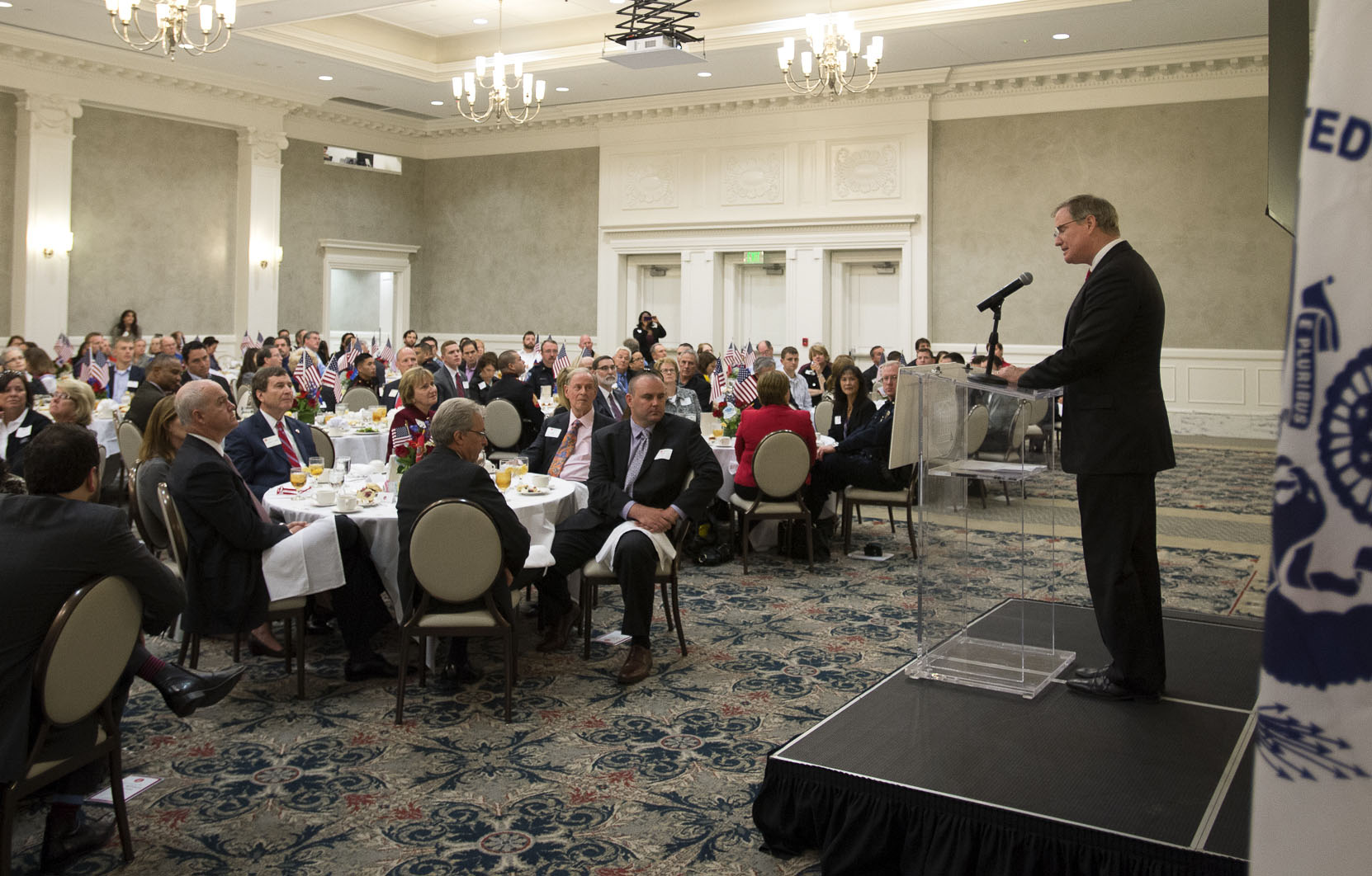 Retired Navy Admiral Patrick Walsh addresses a Veterans Day luncheon at SMU