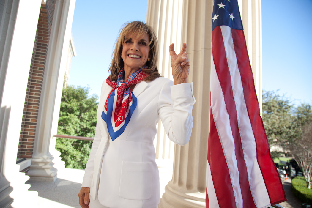 Actress Linda Gray gives the Pony Up sign