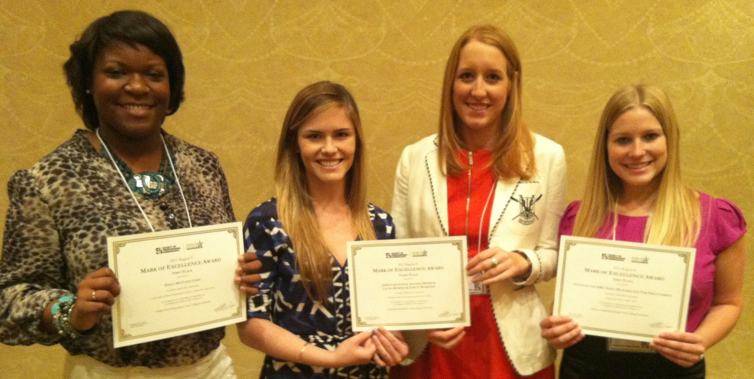 "E'Lyn Taylor (left) accepts the Daily Mustang's 1st place award for Online News Reporting (""Locals Gather at Former President Bush's Home to Celebrate Bin Laden's Death""); Laura Murphy and Jordan Jennings (center) accept 3rd place for In-Depth Reporting (""Discrepancy Between Levels of Public Education Visible in Dallas,"" with Amanda Presmyk and Essete Workneh); and Natalie Posgate (right) accepts the joint staff award for the Daily Mustang and Daily Campus, 1st place, Online In-Depth Reporting, for the Light of Day Project: Campus Crime."