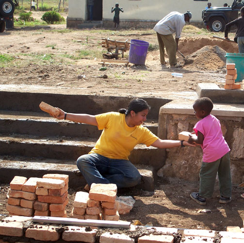 SMU alumna Astrud Villareal helps with a construction project at the Urukundo Home for Children during a Embrey Human Rights Program trip to Rwanda. Photo by Sherry Aikman.