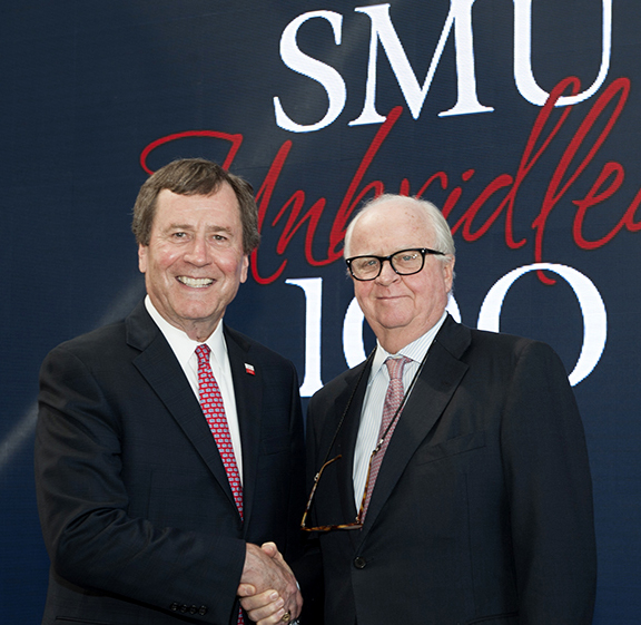 Gerald J. Ford (right) shakes hands with SMU President R. Gerald Turner