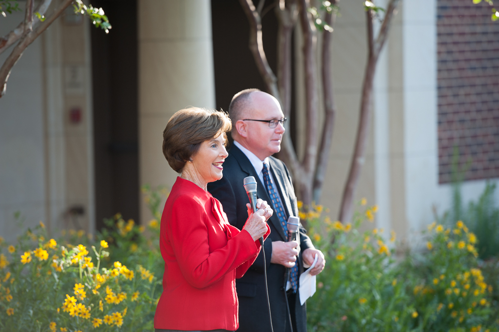 Former First Lady Laura Bush and Alan Lowe, director of the Bush Library, greet reporters in the museum's re-creation of the White House Rose Garden. Mrs. Bush thanked SMU, her alma mater, for its partnership making possible the new presidential library and museum.