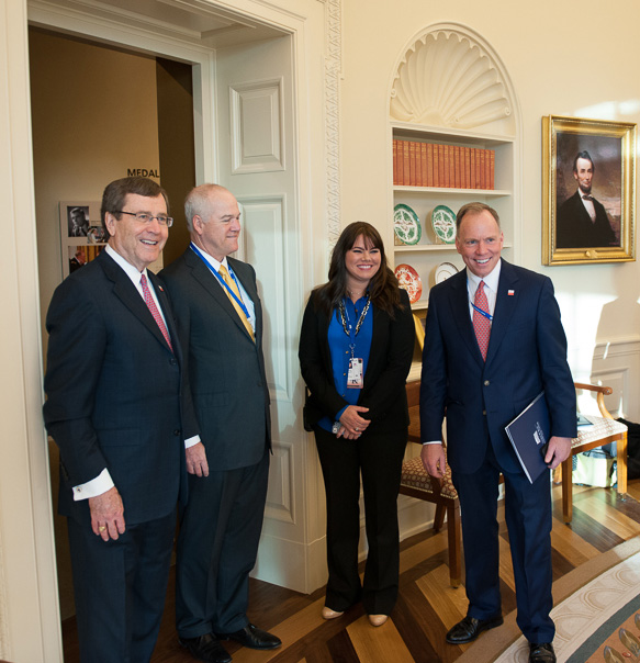Visitors to the museum's replica of the Oval Office include, from left, SMU President R. Gerald Turner, Bush Foundation President Mark Langdale, and SMU Vice President for Development and Public Affairs Brad Cheves.