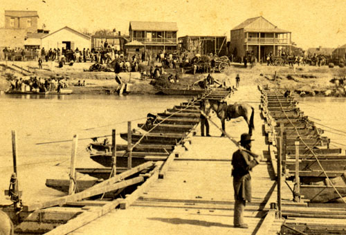 American Side. Pontoon Bridge over Rio Grande River ca. 1866, Louis de Planque (attributed) Robin Sanford Collection. View facing Levee Street, Brownsville during Federal occupation. Note African American soldier from 114th U.S. Colored troops.