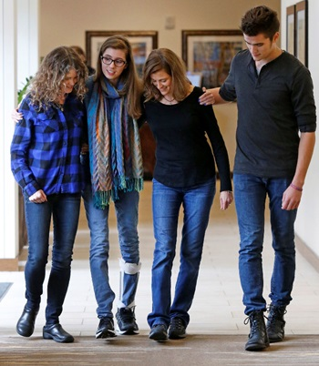 """Audrey Self continues to recover from severe brain injuries suffered in a 2013 car wreck. She is photographed with Team Audrey members, former teacher and mentor Cynthia Anway, left, mother Julie second from right, and brother Ashton, right."""