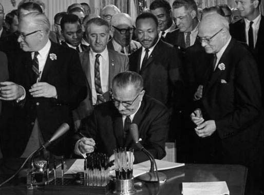 President Lyndon Johnson signs the Civil Rights Act of 1964