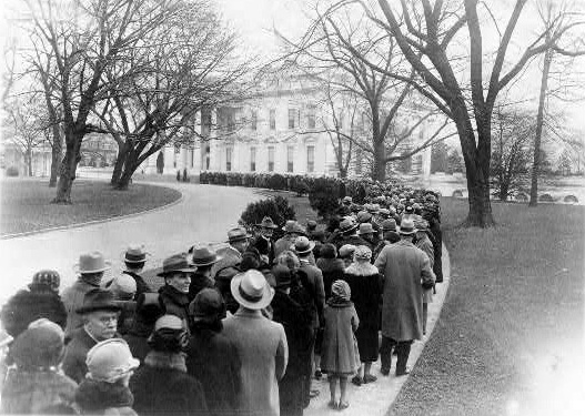 Thousands of Americans in 1927 lined up outside the White House to attend a reception hosted by President Calvin Coolidge. The tradition began with George Washington's presidency and continued through the presidency of Herbert Hoover. Photo courtesy the U.S. Library of Congress.