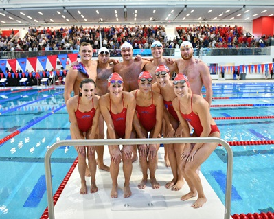 Swimmers at the dedication of the Robson & Lindley Aquatics Center