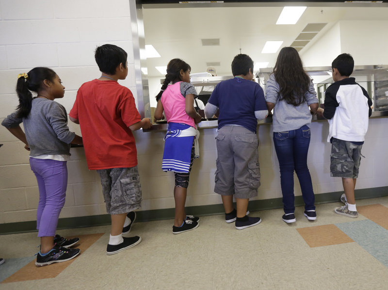 Detained immigrant children line up in the cafeteria at the Karnes County Residential Center. Photo by Eric Gay of The Associated Press courtesy of National Public Radio.