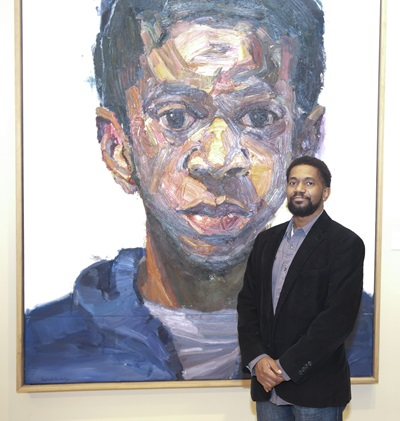 Sedrick Huckaby at the Meadows Museum with his painting Rising, Sonny, Son, (2013-16).