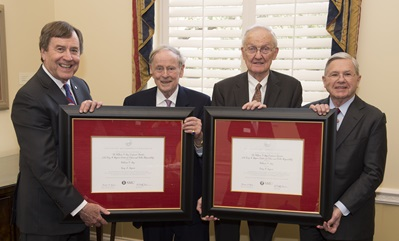 Left to right: President R. Gerald Turner, Cary M. Maguire, William F. May, Michael M. Boone.