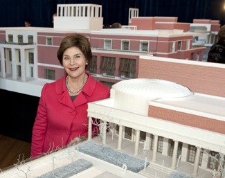 Laura Bush with model of the Bush Presidential Center