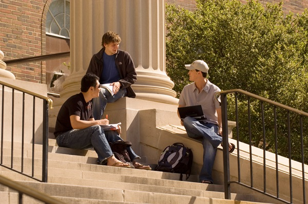 Students sitting on the steps of Dallas Hall