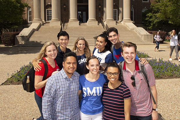 Group of Students standing in front of Dallas Hall.