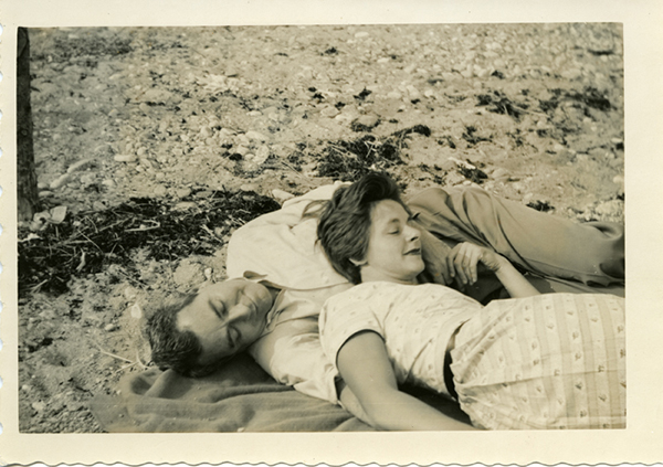 [Horton and Lillian Foote Laying on the Beach], ca. 1950s