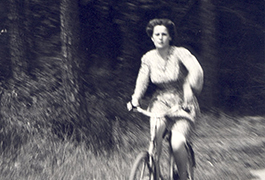 French woman bicycling through the invasion of Southern France, 1944