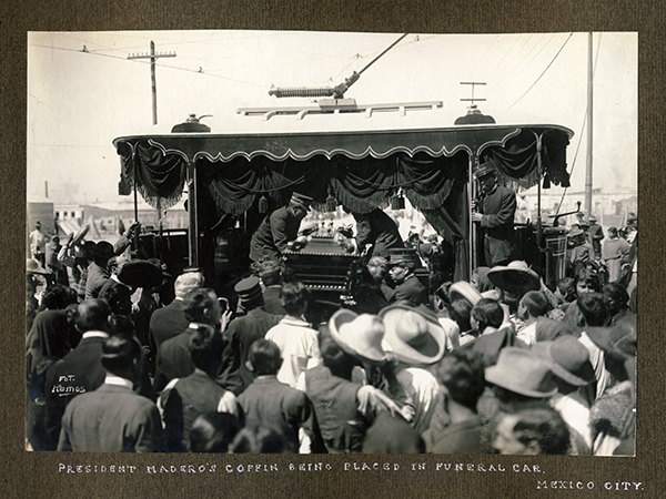 President Madero's coffin being placed in funeral car, Mexico City, 1913