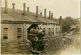 Locomotive crash through roundhouse, ca. 1875-1885