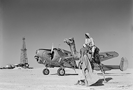 Wildcat well, Beechcraft airplane, and camel, 1946, by Robert Yarnall Richie
