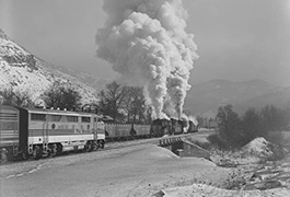 Denver & Rio Grand Western No. 1405 and a 3600-class pushing Carbon County Coal cars at Castle Gate, UT is passed by an e/b F3