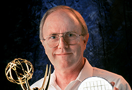 [Dr. Larry Hornbeck with TI's 1998 Emmy Award], ca. 1998