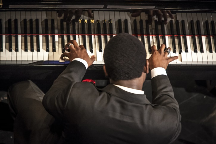 student playing piano shot from behind