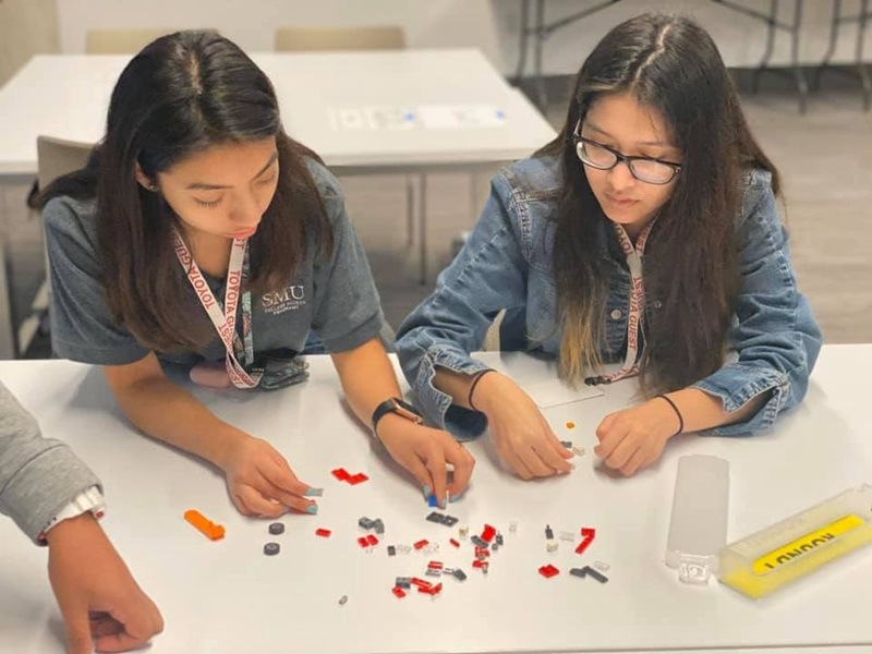 Upward Bound and Upward Bound Math Science Scholars participating in a lego activity at Toyota's Manufacturing Day event.