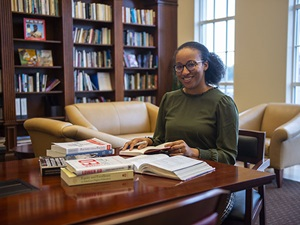 Dr. Baker researching in the Simmons School Reading Room.