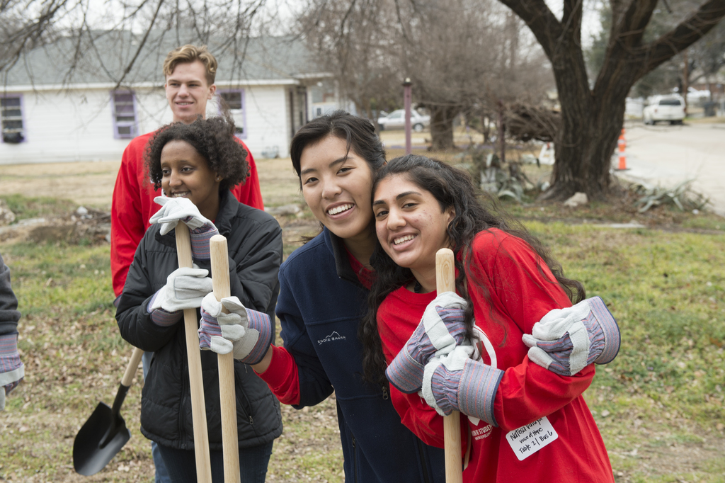 Students pause for photo break after digging at neighborhood site