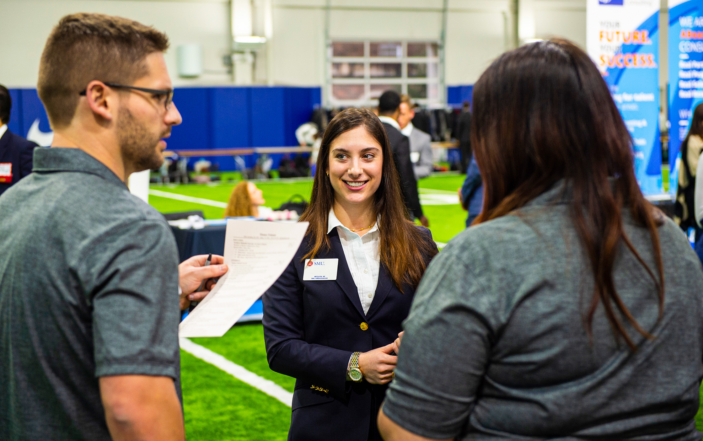 Student meeting with employers during SMU Career Fair