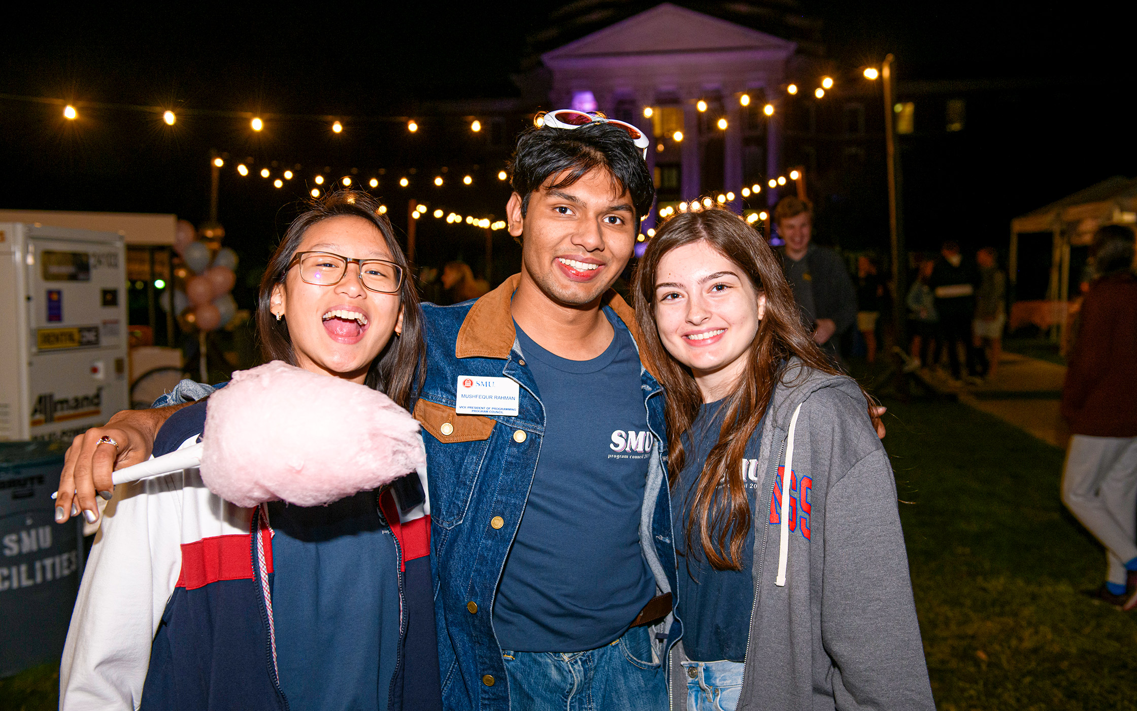Three SMU students at Midnight Market event
