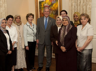 Former President and Mrs. Bush with Iraqi women at SMU