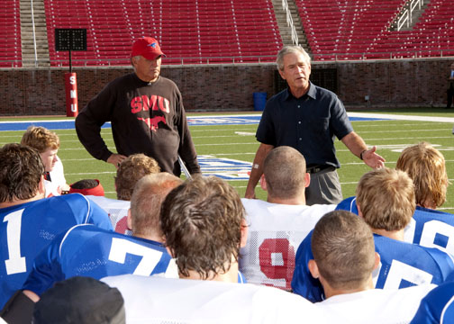 Coach June Jones and former president George W. Bush with SMU football players