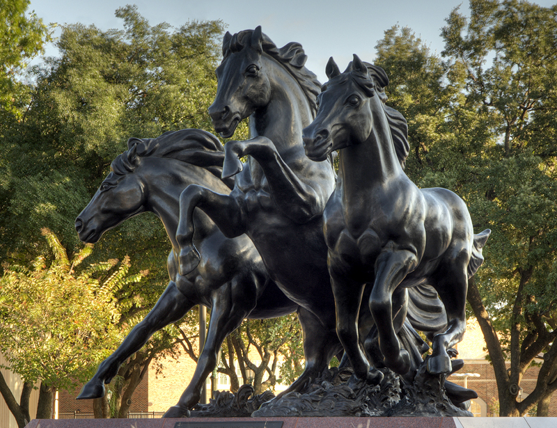 The Mustangs statue at Moody Coliseum