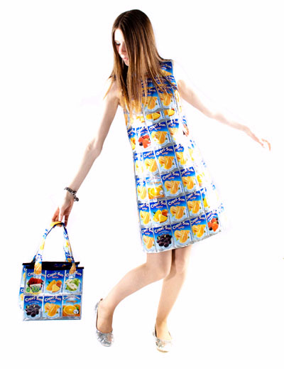 Model with dress and tote bag made from recycled Capri Sun drink pouches