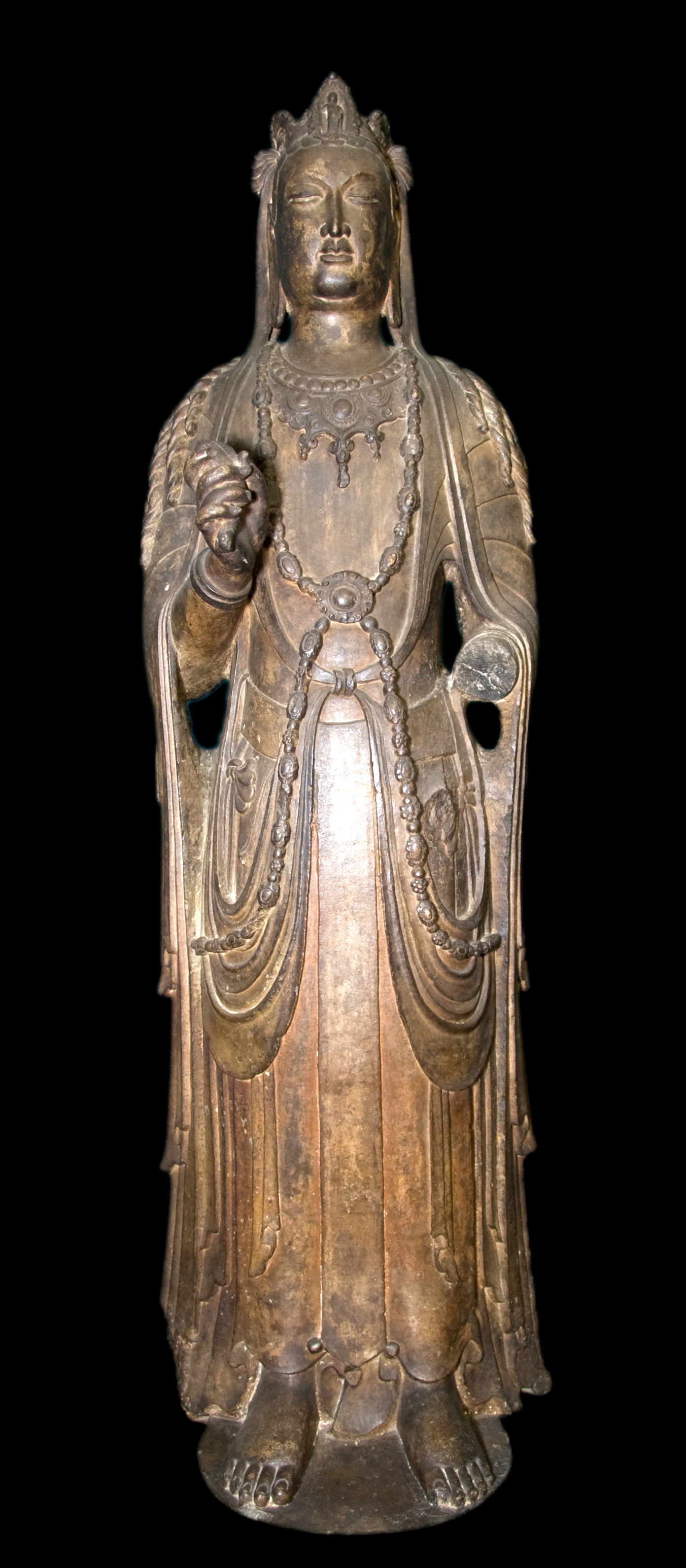 "The exhibit includes this sixth century ""Standing Avalokiteshvara"" from the Buddhist cave temples of Xiangtangshan, China. The limestone sculpture with lacquerlike coating is on loan from the University of Pennsylvania Museum of Archaeology and Anthropology."