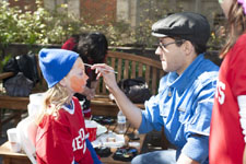 A face-painter at work in Peruna's Playground, SMU Homecoming 2012