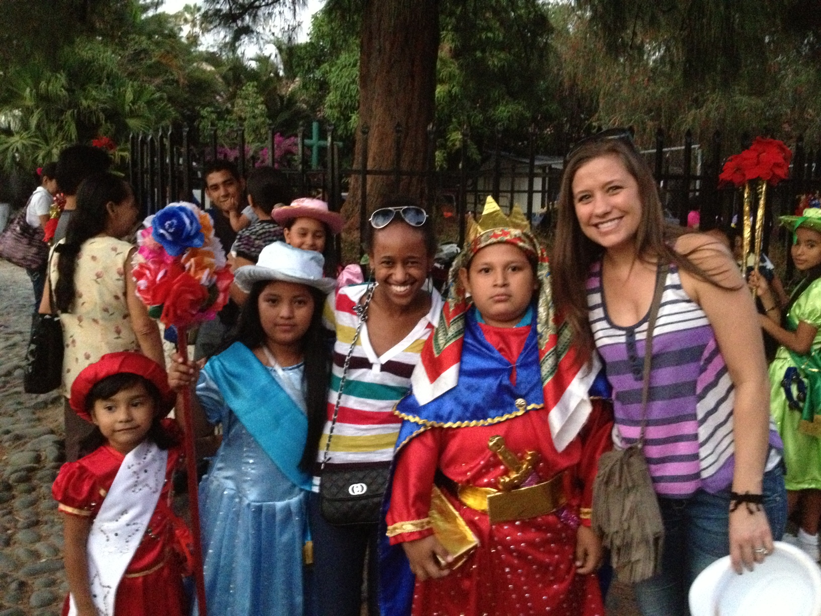SMU students with children in indigenous costumes