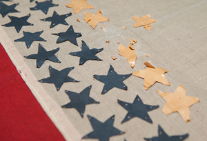 Closeup of blue and gold stars on SMU's 1917 service flag