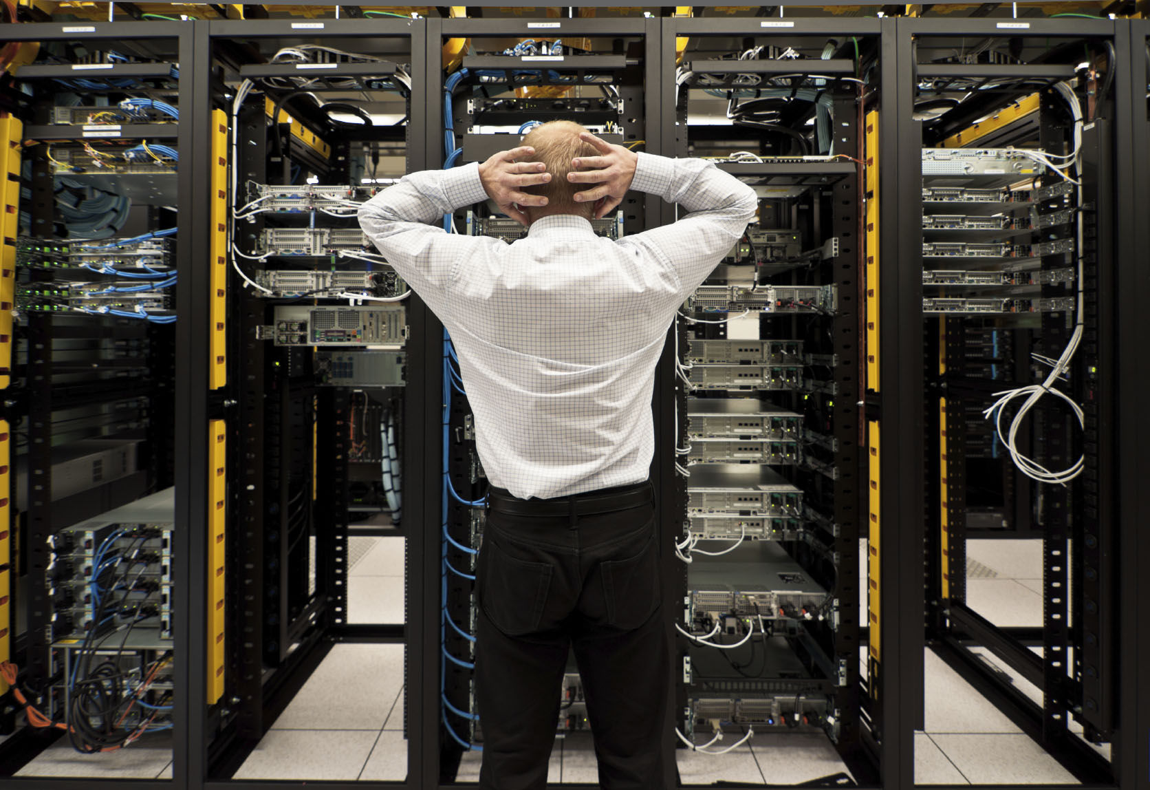 Stock photo of an engineer in a datacenter's server farm