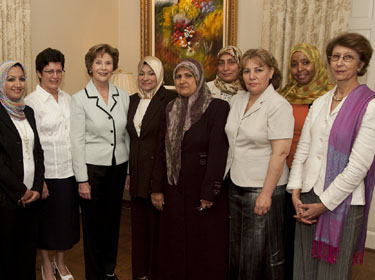 George and Laura Bush visit with Iraqi women at SMU